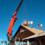 Marer Home 2 - lifting shingles onto the roof