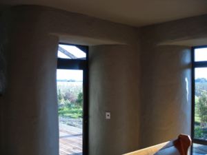 The curved wall interior of a straw bale home
